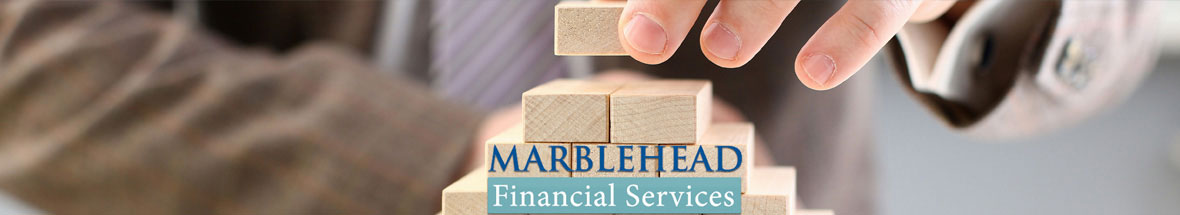 man stacking wooden blocks with the Marblehead Financial Services logo in front