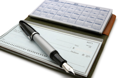 a checkbook with a pen on top